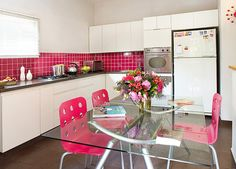 a touch of Fuschia pink in white kitchen.