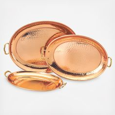 Set of 3 Decor Copper Oval Trays. Each hammered tray is hand-made, each an original work of art. Perfect for an artful buffet display, the solid brass handles make them equally at ease passing hors d'oeuvres at a cocktail party. When not in use make a decorative statement on your sideboard or hutch. A special clear finish deters tarnishing.