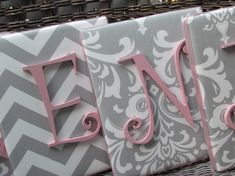 This is another cute idea for a baby girl. I again love the colors (chevrons, paisley prints) and also the (gray and pinks) I think having these either over the crib or maybe hanging over the changing table would be really cute!
