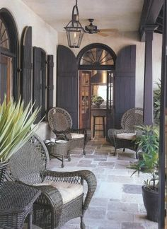 French Quarter courtyard, New Orleans.  Make the open wall a screened in porch with low stone wall for plants and sitting maybe?  Can you hose off the stone flooring every spring for cleaning?