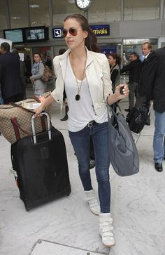 Irena Shayk wears a chic white leather jacket as she arrives at Nice Cote d'Azur Airport to attend the 65th Annual Cannes Film Festival.
