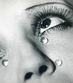 SURREALISM LECTURE Man Ray - Glass Tears, 1932 This image here displays a Surrealist element through the dreamlike characteristics of the photo. The hyperbolic spherical glass tears under the eye heighten the emotion of the image. Man Ray, in doing this has created an image that is atmospherically out of this world.