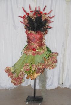 "One of the spectacular floral arrangements(!) of a dress all made of flowers and leaves I saw at a recent Western Cape Province Floral Assoc. demo.  This was designed to depict the movie ""Pretty Woman"". It was made up of bougenvilla, roses, palm fronds, feathers, etc."