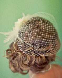 A side updo would look great with my veil-like hairpiece.