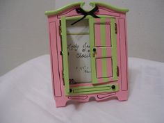 This is adorable  Etsy listing at https://www.etsy.com/listing/192746988/whimsical-armoire-cupboard-photo-frame