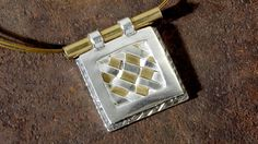Learn how to make this Metal clay woven pendant by Alexandra Daini. Remember the first paper arts technique you ever learned? Use it to weave a sophisticated pendant with silver metal clay and brass. Facet Jewelry. FacetJewelry.com. Art Jewelry.