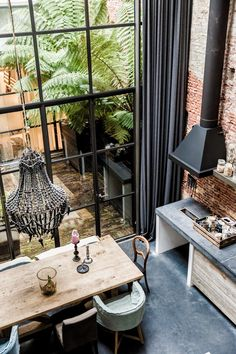 A loft home in Amsterdam -- brick wall, industrial stove hood, huge windows, weathered table, home design interior design house design house design