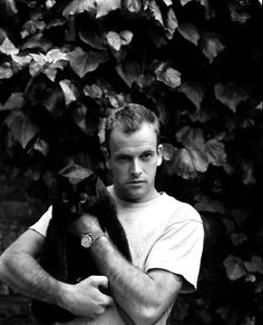 With a black cat no less...be still my beating heart!! Johnny Lee Miller