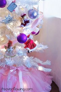 Perfect tree for a little girl.  Find little dolls at thrift stores and hang them on a white tree!  SUPER CUTE!  Details at ItsOverflowing.com.