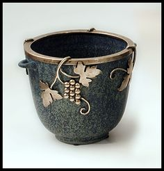 Arne Bang stoneware with silver grapevine mount.