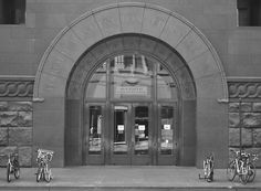 entrance to imagining all things...    East entrance Harold Washington Library, The Loop, Chicago   Nikon D5100, 44mm, f/5.3, 1/40 sec     scott b dragoo     image-and-light.tumblr.com