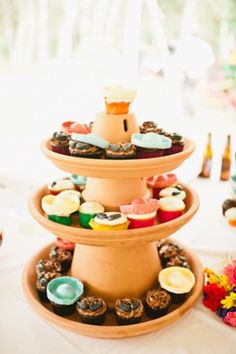 Florida Wedding with Mexican Style Use a terra cotta cake stands as a cute dessert centerpiece at your Cinco de Mayo fiesta!Use a terra cotta cake stands as a cute dessert centerpiece at your Cinco de Mayo fiesta! Mexican Birthday Parties, Mexican Fiesta Party, Fiesta Theme Party, Taco Party, Festa Party, Fiesta Party Centerpieces, Mexican Candy Bar, Fiesta Decorations, Mexican Dessert Table