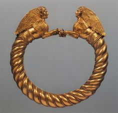 Gold, enamel and bronze Greek bracelet with a pair of winged Sphinxes forming the clasp - 400 BC.