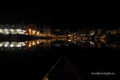 Trondheim at night from kayak perspective