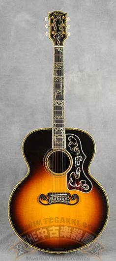 Gibson 100th Anniversary Custom SJ-200 (1994) : Gibson's master luthier Ren Ferguson produced 4 gorgeous SJ-200s to celebrate their 100th anniversary. This is one of them with Madagascar rosewood.
