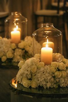 Candles With Hurricanes and White Floral Wreaths.