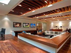 (Sunken lounge) How awesome would this place be during football season. Three televisions playing different games at the same time. A huge couch so everyone can relax. The wood planks in the ceiling is awesome as well!
