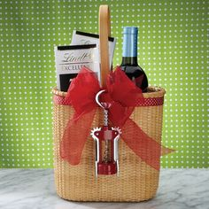 this is such an adorable idea or wine and chocolate lovers - the basket is so cute and the corkscrew is a great idea.. something that can be thrown together quickly with a trip to Home Sense