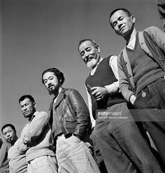 Portrait of a line of men at Tule Lake Segregation Center, an internment camp for Americans of Japanese descent, Tule Lake, California, March 1, 1944. (Photo by Carl Mydans/The LIFE Picture Collection/Getty Images)/Getty Images)