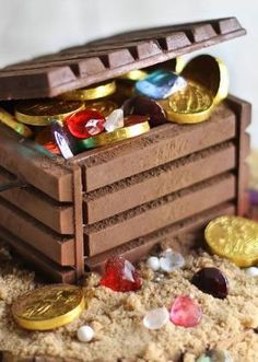 Candy jewels and chocolate coins fill this DIY edible treasure chest. Great for a pirate birthday cake. by jodie brackin