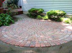 Circle paver patio perfect for a cocktail hour! #besawslandscaping #michigan #hardscape #dreamybackyard