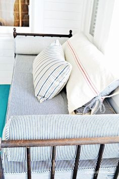 Cozy daybed on the sleeping porch via Ebbtide Cottage on Tybee Island