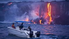 Lava Ocean Tour passengers watch lava from Kilauea on Hawaii Island. Picture: Hawaii Tourism Authority