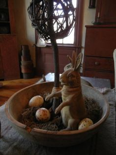 Bunny, eggs, wooden bowl, not whatever that is tree or something.  *needs a twiggy tree instead.