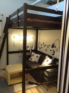 IKEA loft bed w shelf attached (clipped?) to the side for drinks/pics, side table
