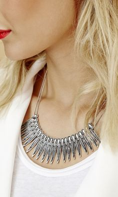 Necklace with fringe, feather-like detailing in silver-toned metal
