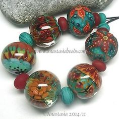 ANASTASIA-lampwork-beads-6-POINSETTIA-SRA http://www.ebay.com/itm/261660158134?ssPageName=STRK:MESELX:IT&_trksid=p3984.m1555.l2649