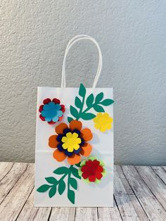 This listing is for 6 goody bags. This cute goody bags would be a great addition to your Fiesta/ Mexican themed or Hawaiian themed party. Bag color- white Bag Size - 5.5x8.5 inches Bags are fully assembled and ready to use. The colors of the flowers can be customize to match you event. Please make sure to browse for additional items in my shop coordinating to this theme. Includes large paper flowers, small paper flowers, banners , cup cake toppers etc. Goody Bags, Treat Bags, Luau Party Supplies, Hawaiian Decor, Girl 2nd Birthday, Large Paper Flowers, Backdrop Decorations, Mexican Party, Party Bags