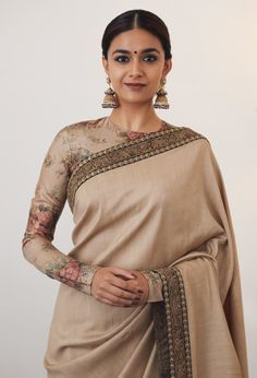 Cream coloured Indian authentic saree which is paired up with jumkhas are the perfect goal for ethnic occasion, and not to mention full sleeved floral blouse! Indian Dresses, Indian Outfits, White Off Shoulder Dress, Off Shoulder Blouse, Elegant Girl, Saree Trends, Stylish Sarees, Trendy Sarees, Saree Look
