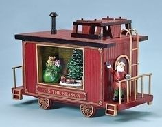 Train Caboose Car Music Box with Christmas tree, bag of toys and elf conductor. Plays Christmas Songs: Jingle Bells, Oh Christmas Tree, We Wish You A Merry Christmas, Deck the Halls, Silent Night, Joy