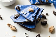 Melt chocolate into slabs, coat with blue candy-melts, and stud with broken oreos and edible googly eyes and voila: it's as though you blenderized a thousand Cookie Monsters, rolled them flat…