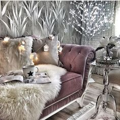 luxurious sitting area, frosted purple velvet sofa, snow/ ice grey furnishings