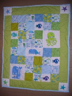 Blue, Green and Purple Ocean Fish Octopus Nursery Quilt. $80.00, via Etsy.