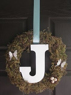 DIY Wreath. I like the large letter in the middle. I want to do this with burlap.