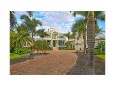 Tucked away on north Siesta Key, Florida, this gated estate on deep boating water is a superb expression of coastal contemporary style. Custom-built in 2011 by JE Tucker, Inc. the expansive 6/6 pool home is a must see. White Ln, Sarasota, FL 34242 - MLS A4176892