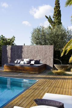Nice outdoor space. I like the lounge chair setup and the wood flooring.