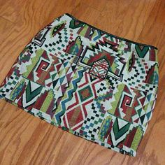 AZTEC print skirt Multicolored aztec print skirt with faux leather trimming on waist. Looks great when paired with thigh high boots!  -Size Small (measures 24 inches around waist) -Mini skirt ( measures 12 in from waist) -Side zipper with metal clasp.  -Like new. Worn once. -no trades Skirts