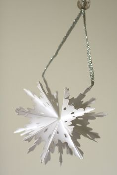I've got a really fun 3D Christmas ornament to show you! It's very inexpensive to make (paper, ribbon and a bead) and is so interactive...