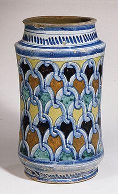 Albarello  Date: ca. 1480–90 Culture: Italian (Naples) Medium: Maiolica (tin-enameled earthenware) Dimensions: Overall (confirmed): 12 3/16 x 6 7/8 x 6 7/8 in. (31 x 17.5 x 17.5 cm)