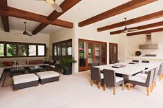 Outdoor dining area and living room with summer kitchen