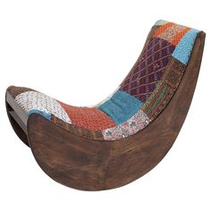 Intriguing wood rocking chair features a patchwork-upholstered seat and back from Joss & Main