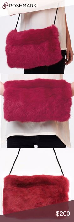 """NWT, Rabbit Fur Hand Muff Stunning and RARE hand muff from the designer C/FAN. It is their classic Bobby Muff in the color Flamingo.  Brand new with tags and still in dust bag.  Nothing beats the softness and color of this gorgeous hand warmer muff. Cover photo is not actual item, just shows ideas for styling.   RABBIT FUR HAND MUFF WITH SHOULDER STRAP AND HIDDEN POCKET 12"""" WIDTH X 9"""" LENGTH 5"""" WIDTH X 5"""" LENGTH HIDDEN POCKET  100% RABBIT FUR WITH MICROSUEDE LINING C/FAN Bags"""