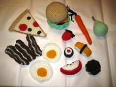 """I made some play-food for a relative.  Some of the patterns are from Rose Langlitz's book """"Tasty Crochet"""" and some are from Elisabeth Doherty's book """"Amigurumi"""".  They were all fun and quick to make!"""