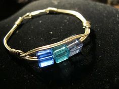 Naomi's Designs: Handmade Wire Jewelry: Silver wire wrapped bracelet with blue and turquoise crystals