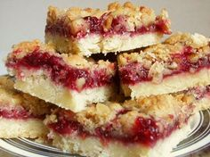 Amazing, melt-in-your mouth Raspberry Streusel bars. I like that these use fresh berries instead of just jam like many other bars. They disappear in minutes at any potluck - definitely a keeper.