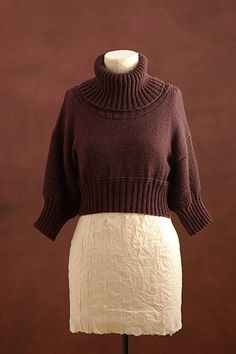 Free Cropped Turtleneck pattern from Lion Brand.  Can be worn two ways....wear it bottom up and you have a fitted boat neck sweater.  Love this....